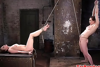 Restrained sub babes enjoying oral session