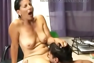 Mature in office with her son