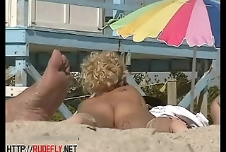 Amazing nudist  hotties bathing in sun at the beach