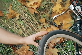 Nude gay bear cyclist stripping and masterbating under the autumn tree