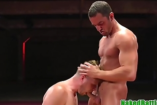 Wrestling stud gags on cock while sucking
